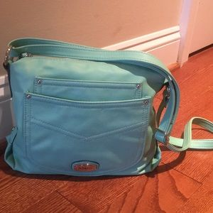 Lots of compartments, like new! Adjustable strap